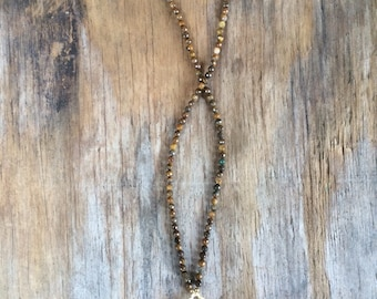 Long Beaded Tassel Quatrefoil Clover Pendant Necklace with Faceted Tiger Eye Beads and Gold Quatrefoil