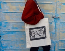 Hand printed lino Apple vegan tote bag unique quirky tote bag with pattern border black and white