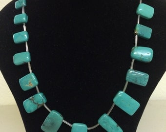 Turquoise gratuated flat slabs, Natural turquoise. 15 1/2 inch strand, For 19pcs(TP465)