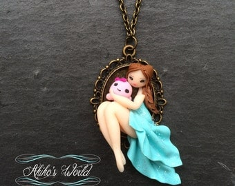 Tiny chibi in her blue dress with a kawaii octopus plush - Bronze cameo of 18 per 25 mm - Polymer clay pendant