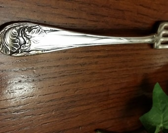 Fleur de luce  fork.  circa 1904. silver plated   measures approximately 6 7/8 inches