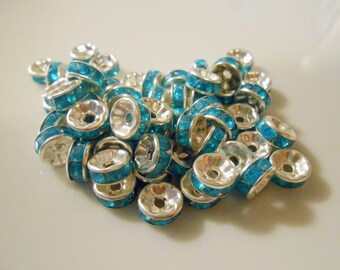 Rhinestone spacers. Aqua blue crystal spacer beads. Silver plated rondelle spacer beads. 8 mm round spacers. Destash. Jewelry Supplies