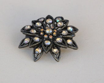 Dark silver brooch with aurora borealis stones