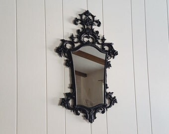 Vintage painted black matte ornate mirror