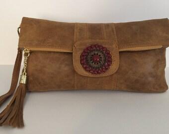 Brown leather handbag.