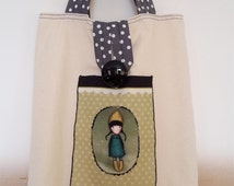 Handmade tote bag with black button and animated picture