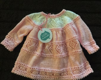 Beautiful lovingly, hand-knitted pink and white baby dress