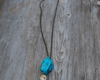 Turquoise rock necklace with skull and rose charm