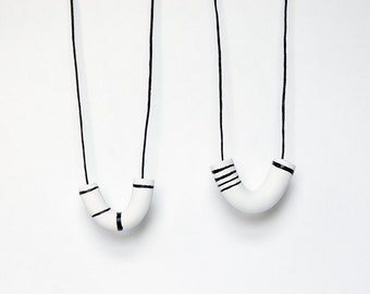 minimalist hand drawn lines U shaped clay necklace