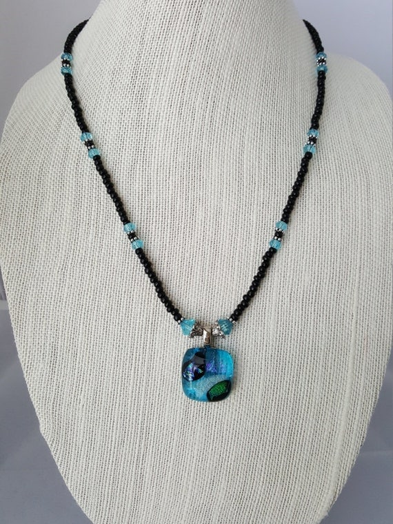 Black beaded necklace with fused glass pendant