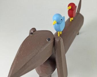 Big Doxie with Bird Buddies