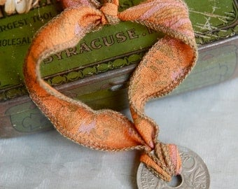 Sari silk ribbon coin bracelet / French coin bracelet / bohemian bracelet. Tiedupmemories. Tiedupmemories