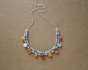 Casual blue necklace with orange carnelian drops