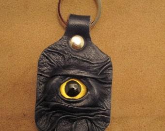 Grichels leather keychain - dark blue with custom gold fish eye