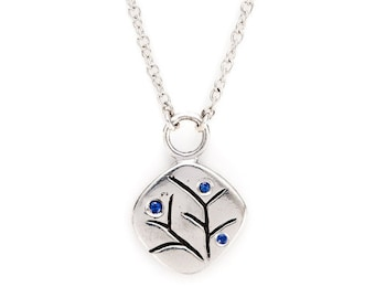 "silver pendant with sapphires. carved nature motif. ""spring blossom"""