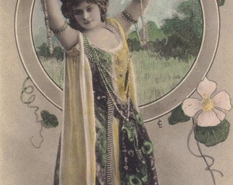 Mlle. Tiphaine with Pearl Slave Bracelets, by Reutlinger, circa 1905
