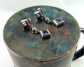 Silver and purple dangle earrings