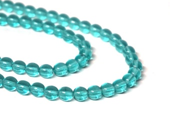 "6mm round Czech Glass Beads, Transparent Teal Blue, 11"" bead strand, 50 beads  (1164G)"
