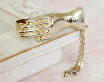 Vintage Glove Clip in Gold Metal and in the Shape of a Hand