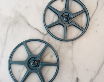 """Vintage 6"""" Movie Reels, blue reels."""