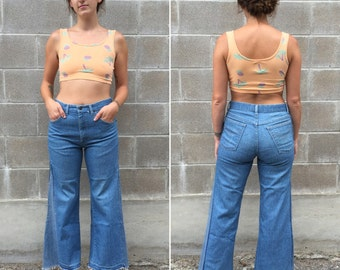 70s cropped bell bottom flares / mid-rise waist / raw hem / Size 32/29