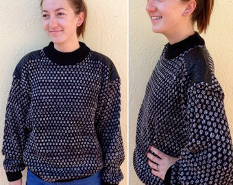 oversized black & grey spotted knit sweater w/ leather shoulders
