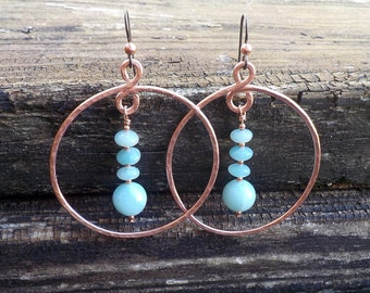 Hammered Copper Hoop Earrings with Aqua Beads. Blue amazonite beads dangle in 1 3/4 inch handmade hoops of hammered copper.
