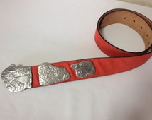 Vintage Carlos Falchi red suede leather belt with silver fun and unique animal motifs. Great masterpiece.  US28, 29, 30, 31, 32, 33