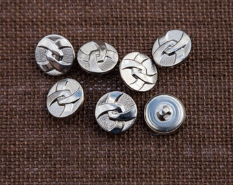 "7 Vintage 3/4"" Metal Shank Buttons. Shiny Silver Interlocking Ribbon Design. Textured Background. Well Made. Sewing, Applique. Item 3735M"