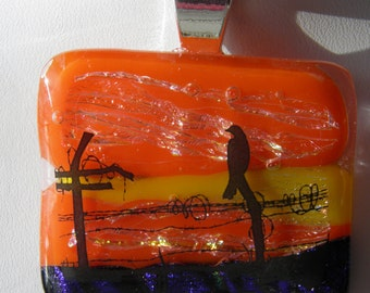 Silhouetted Black Bird on a Wire at Sunset Dichroic Fused Glass Pendant