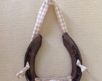 Tan burlap button and bow lucky horseshoe