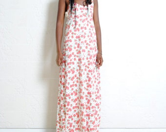 Cotton dress with curling on the back. On sale from 89 euro to 44,50