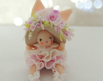 Bunny with wee bunny slippers and wire glasses Miniature Figurine