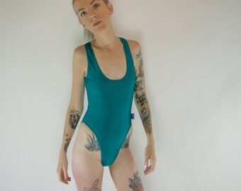 High cut low back turquoise swimsuit