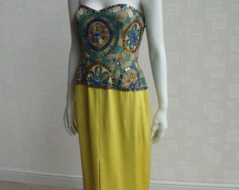 Darnell of London Couture yellow silk-satin, crystal and bead embellished stage gown