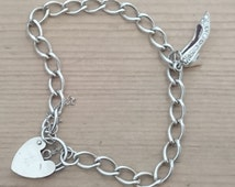 Vintage sterling silver charm bracelet with a rhinestone silver shoe charm