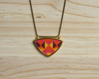 Hand embroidered pendant necklace.