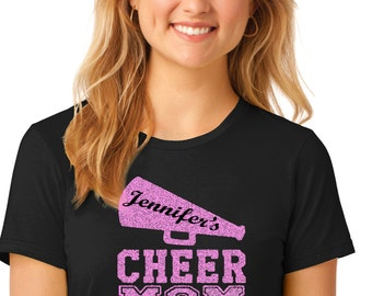 Glitter CHEER Mom Tee with Cheerleader Name.  Ladies & Men's sizes in 100 colors of shirts.  Ships in 1 to 3 days.  Cheerleader Mom