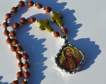 Saint Kateri Tekakwitha necklace knotted with golden sand beads and howlite crosses