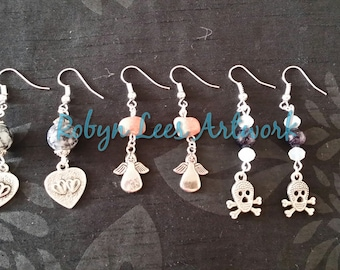 Silver Angel and Pink Stone Earrings; Galaxy, White Opal and Skull and Crossbones Earrings and Black & White Veined Double Heart Earrings