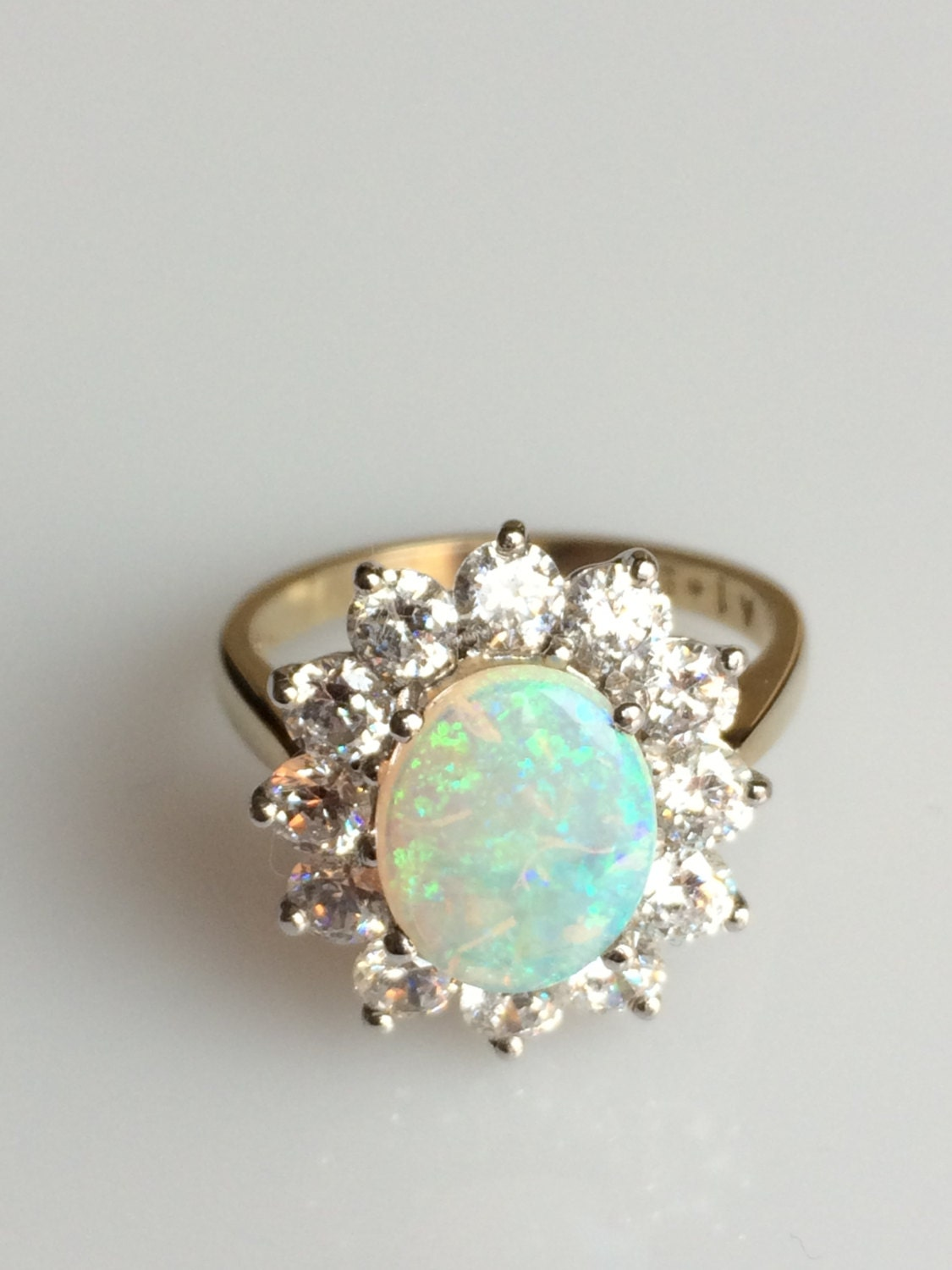 gold opal engagement ring and opal ring by arahjames