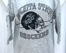 NOS Vintage 1980s Wichita State Shockers Football Jersey Style T-Shirt Collegiate Pacific Grey Tee Size L Shockers Helmet WuShock