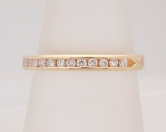 0.20 Carat T.W. Ladies Round Cut Diamond Band 10K Yellow Gold Ring