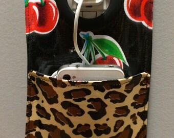 Oilcloth fabric phone charging pocket, cheetah print, cherry print, oilcloth fabric