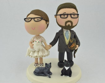 Couple holding hands and their cats. Wedding cake topper. Wedding figurine. Bride and Groom. Handmade. Fully customizable. Unique keepsake