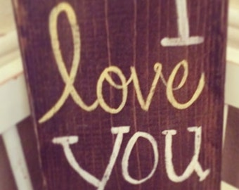 I love you more wood sign