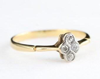 Edwardian 4 stone old european cut diamond engagement ring in 18 carat gold