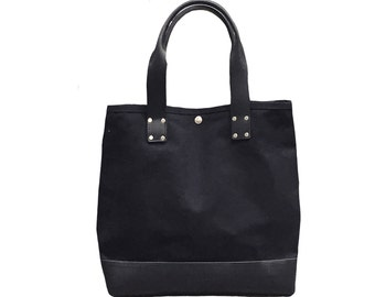 Black tote bag with black leather