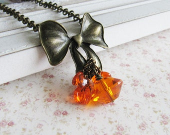 Orange necklace, bow necklace, orange pendant, orange jewelry, gift for her, bronze vintage style jewelry