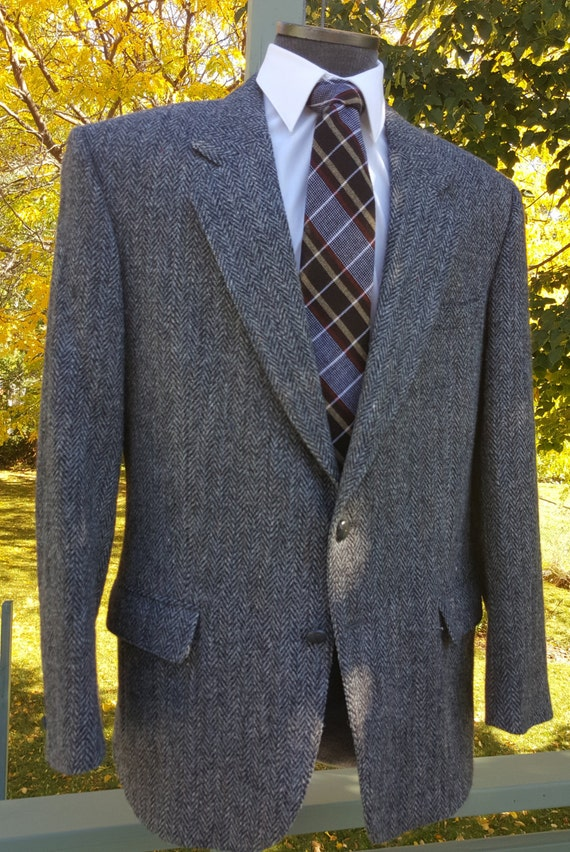More Details Neiman Marcus Men's Herringbone Two-Button Wool Jacket Details Neiman Marcus jacket in herringbone wool. Notched lapel; two-button front. Four-button detail at cuffs. Welted barchetta pocket at chest. Patch pockets at sides. Double-vented back. Wool. Made in Italy.
